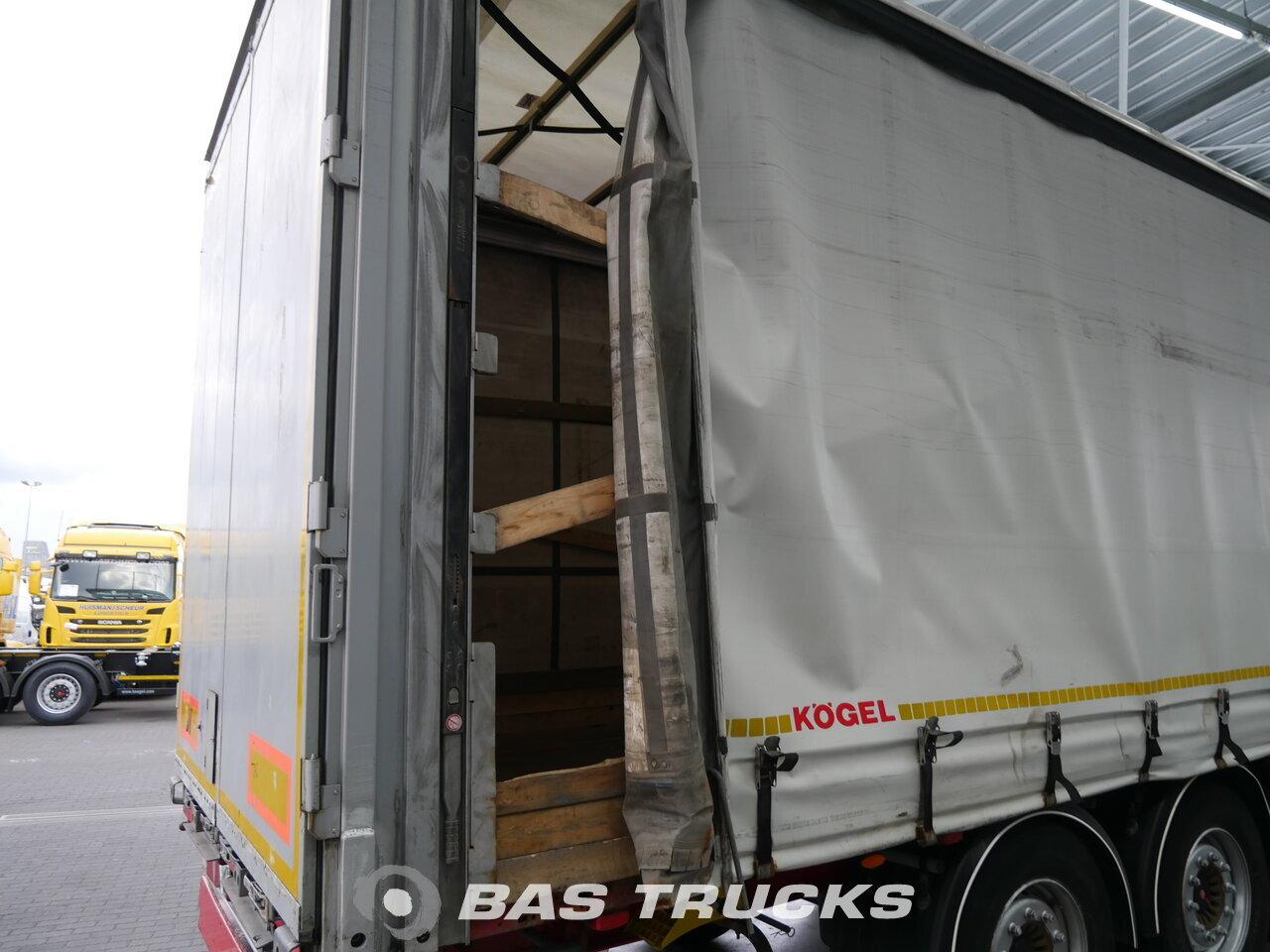photo of Used Semi-trailer KOGEL Hubdach mit Rungen SN24 Axels 2012